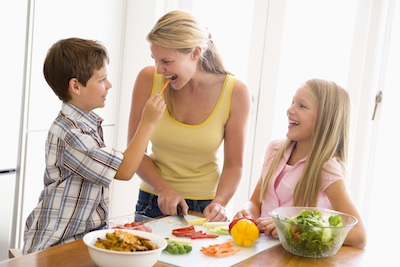 Mother And Children Prepare A meal,mealtime Together