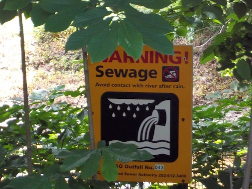 A sign near the Washington D.C. zoo, providing an alert about sewage dumping.
